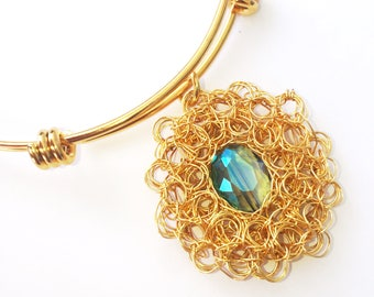 Gold-filled. Wire woven crystal adjustable bracelet. Cuff with Crystal set in tissue. Adjustable.