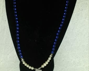 Blue and white pearl necklace, earrings, and bracelet