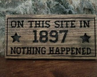 On this site in 1897, Nothing Happened! wood sign