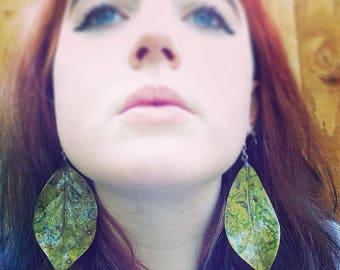 Real leaf dangle hook earrings. Made using natural and locally-sourced leaves from Peckham Rye park, varnish, and stainless steel hooks