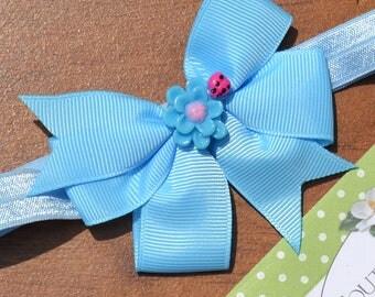 Blue Baby Headband. Light Blue Soft Satin Headband with Blue Grosgrain Bow and Cute Blue Resin Flower Center. Fits Newborns to Teens.