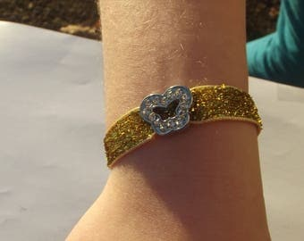 Child bracelet in gold fabric glitter with Silver Clasp and little Butterfly passing silver with Rhinestones.