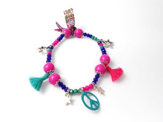 Bracelet grigri peace sur fil lastique cristal pompons - Fil elastique pour bracelet ...