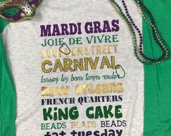 Mardi Gras Descriptive Raglan Tee