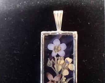 wildflowers glass silver - Flower Arrangement on Purple Art Glass.
