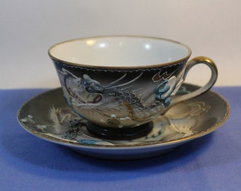 Amazing and Fabulous Vintage Raised Dragon Cup & Saucer