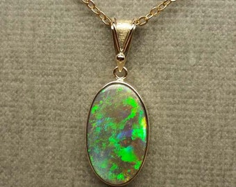 Lightning Ridge Black Crystal Opal. Solid 9ct Yellow Gold Setting.