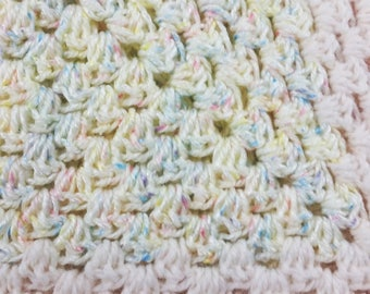 Yellow & pink crochet baby blanket with confetti-style yarn