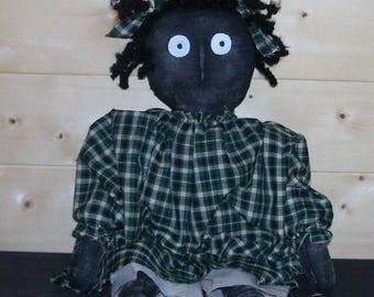 Primitive black doll