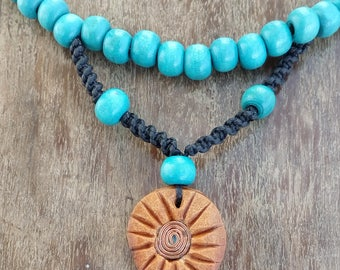 necklace with avocado stone and blue wooden beads