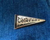 Colorado pennant flag - enamel pin made from block-print by Sara Schalliol-Hodge