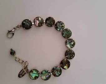 OOAK Tennis Bracelet with 12mm round Paua Shell Cabochons in a rhodium plated setting with lobster clasp