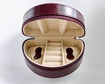 A travel jewelry box, folding zippered case, brown leather, beige ring rolls, travel clutch purse, small valet tray crescent shape