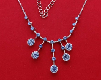 "Vintage silver tone 18"" necklace with blue rhinestones  in great condition, center dangle 1.5"" and not stationery"