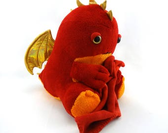 Sleepy red dragon plush