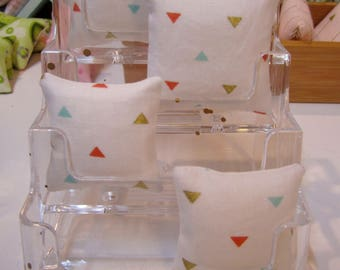 1:6TH Scale (Large) Miniature Pillow in a modern White with Triangles in Aqua, Coral, and Gold