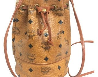 Vintage MCM brown monogram small hobo bucket bag. mini purse. Made in West Germany. Designed by Michael Cromer.