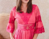 vintage 1970s electric pink bohemian dress with sheer lace waist & bell sleeves
