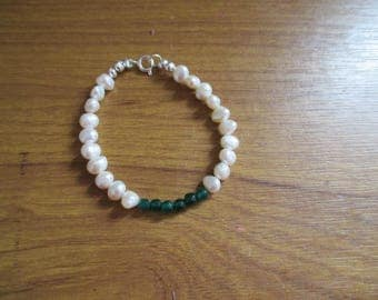 freshwater cultured pearl bracelet with green swarovski beads.