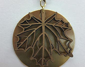 Brass plate with wood maple leaf.