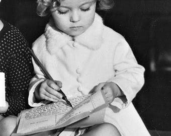 Shirley Temple signing her first film contract, 1932