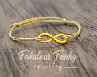 Infinity bracelet - beige/gold