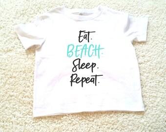 Eat beach sleep repeat graphic kids Tshirt. Sizes 2T, 3t, 4t, 5/6T funny graphic kids shirt