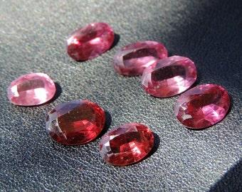 Red Garnet and rhodolite Garnet.