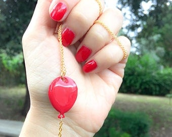Brass long necklace with enamelled balloon pendant