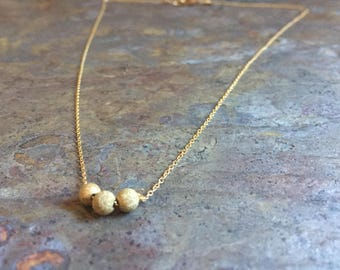 Gold filled necklace with gold stardust beads