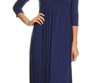 A SUPER-SOFT  stretch knit, maxi dress features an Empire waistline with 3/4 sleeves