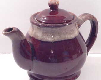 A Vintage PotteryTeapot in Rich Brown with Stoneware Accents around the Neck, Spout, Handle and Lid offered by Crafts by the Sea