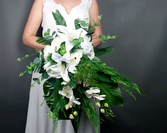 White wedding bouquet tropical greenery leafs orchid lily flowers bridal bouquet cascade ferns eucalyptus monstera banana leaf big cascading