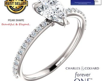 1.25 Carat Pear Shape Moissanite (Forever One) Ring in 14K Gold (with Charles & Colvard authenticity card)