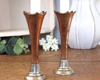 Pair of vintage copper candlesticks with fluted rim and contrasting silver toned bases