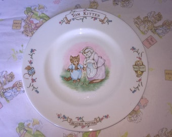 Beatrix Potter Tom Kitten plate. Tom and Mother Cat in the middle with other characters on the rim. 8 1/4 ins diam. plate to use or display.