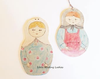 Wall decor dolls, Pair of clay nesting dolls