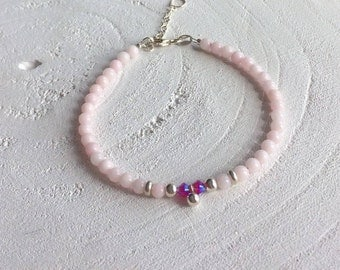 Bracelet with light pink Jade beads and 925 sterling silver beads. With a 925 sterling silver bead and conclusion