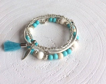 Summer bracelet set with leather strap, cream-coloured and white beads, silver beads, blue beads, charm and tassel