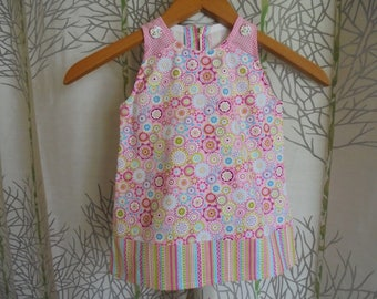 Baby 6 months of two prints/floral graphic pink and multicolored cotton dress.