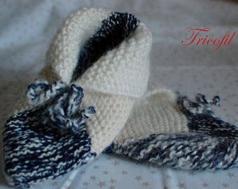 Blue and white booties made for child or adult hand