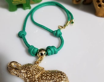 Beautiful mystical elephant, golden color with green cord,