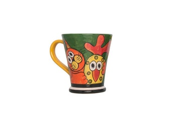 Mug with cat and rooster on green background