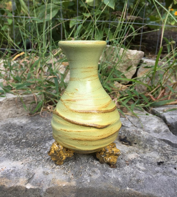 porcelain vase in beige, golden yellow, and pale green