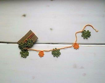 Decorative flowers garland green and orange home decor