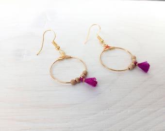Earring, hoop and violet pink tassel