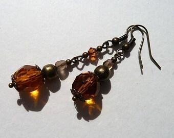Yellow/orange, brown and bronze asymmetric earrings