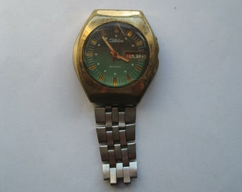Vintage Soviet wrist mechanical watch SLAVA. In non-working condition.