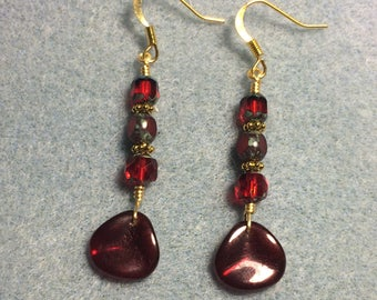 Dark red rose petal dangle earrings adorned with dark red Czech glass beads.