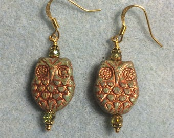 Olive green with copper wash Czech glass owl bead earrings adorned with sparkly olive green Chinese crystal beads.